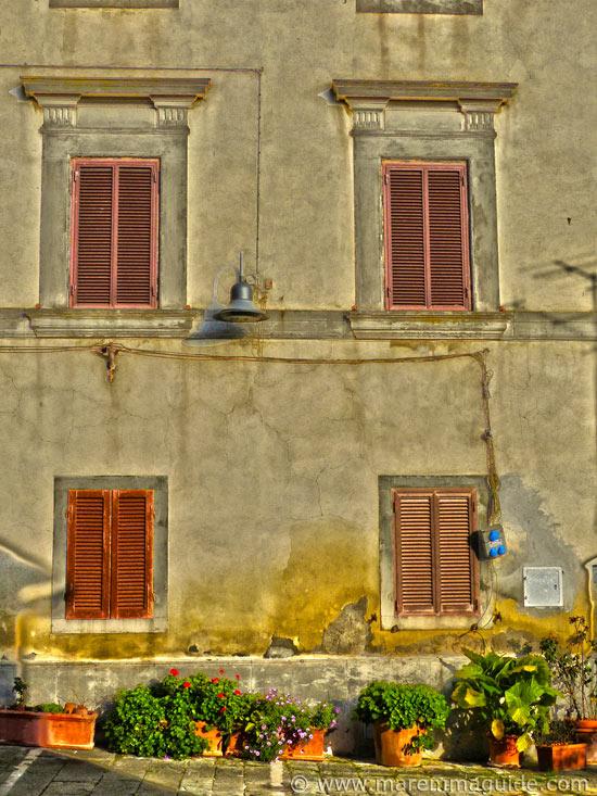 Building in Piazza della Repubblica in Pereta in late afternoon winter sunshine