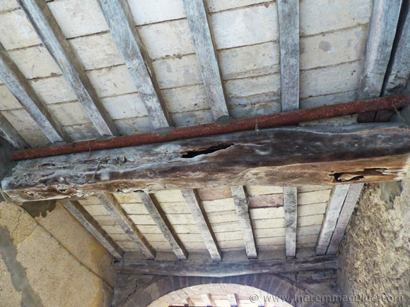 Rotten wooden support beam of medieval gateway in Pereta.