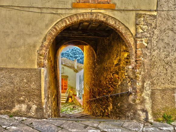 Medieval arched entrance to Pereta in Tuscany Italy.