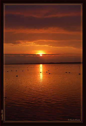 An orange sunrise over Lago di Burano
