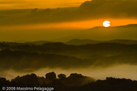 Sunset Images: orange sunset over Maremma