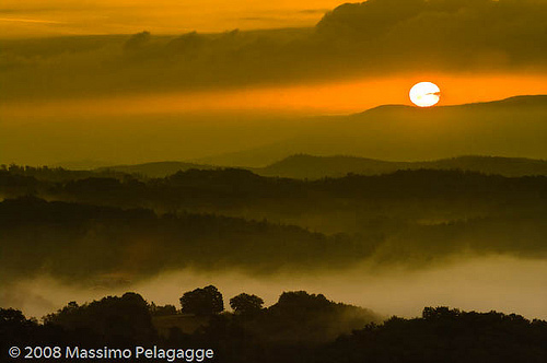 A stunning orange sunset image over Maremma