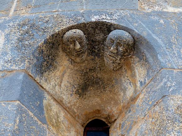 Pieve di San Giovanni apse: face sculptures