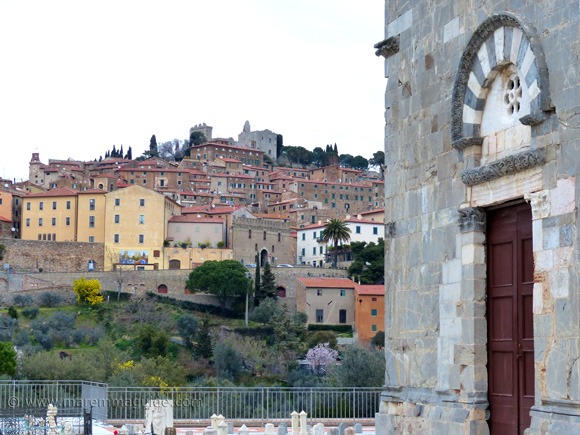Pieve di San Giovanni front door and view to Campiglia Marittima