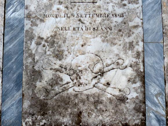 Corss and skullbones grave slab in Pieve di San Giovanni, Campiglia Marittima Tuscany