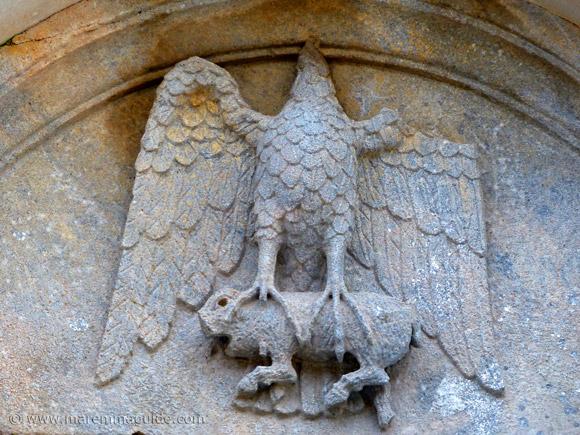 Pieve di San Giovanni: headless eagle and four-legged creature, Campiglia Marittima