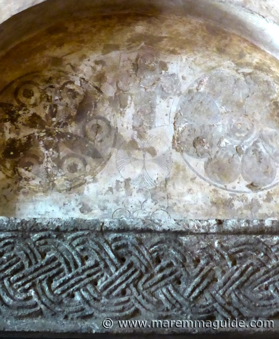 Knights Templar graffiti signs detail in the church of Pieve di Santa Maria ad Lamulas Tuscany Italy.