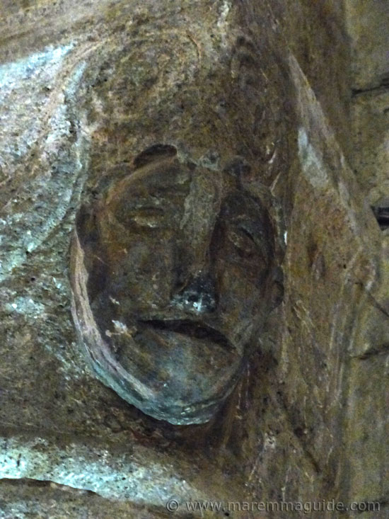 Etruscan mask stone carving on a column in the church of Pieve di Santa Maria ad Lamulas