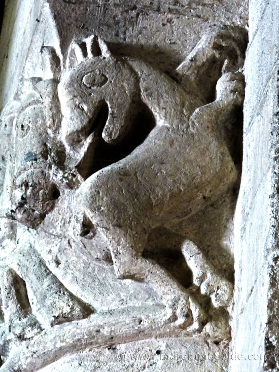 Stone carving of a beast in the Pieve di Santa Maria ad Lamulas