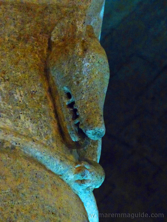 The face and claw of the wild beast stone carving in the pagan church of Pieve di Santa Maria ad Lamulas