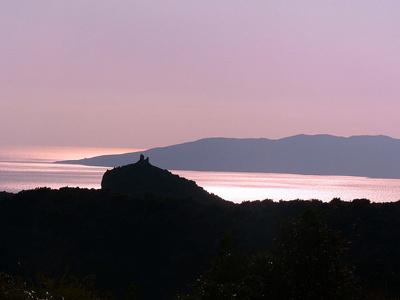 Pink Maremma sunset over Monte Argentario in Maremma Italy