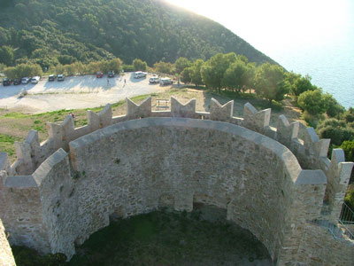 Populonia medieval fortress walls with view of car park