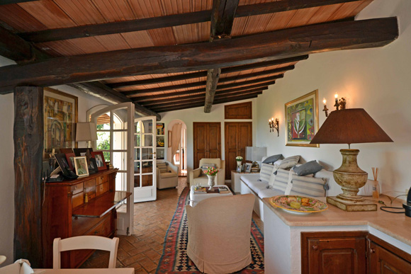 Traditional stone built Porto Ercole house for sale: living room.