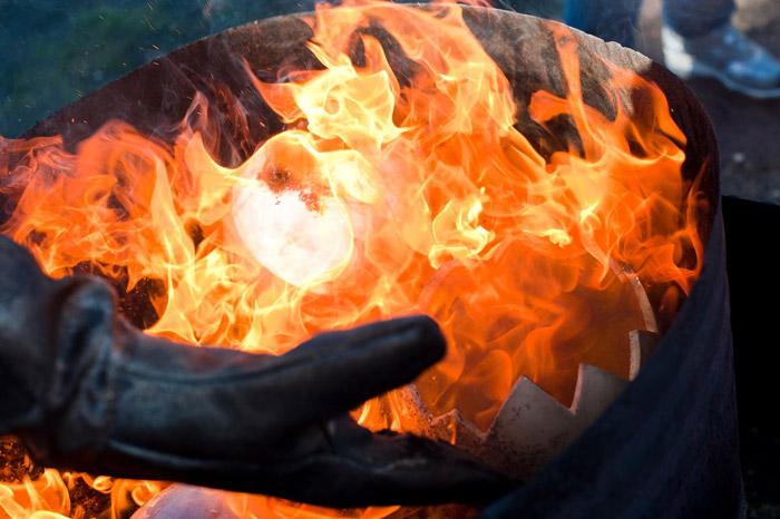 Raku pit fire at a pottery workshop Tuscany