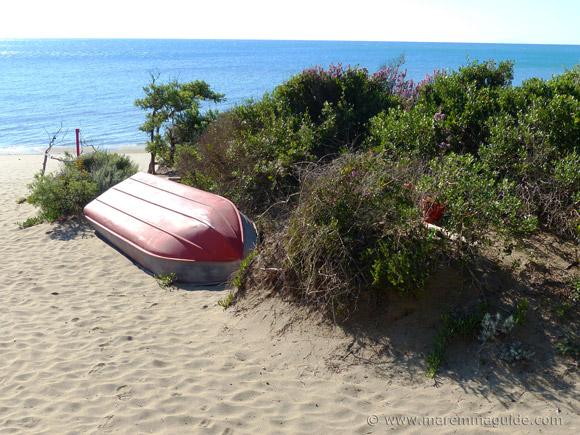 Boat on Riva del Sole beach Castiglione della Pescaia.