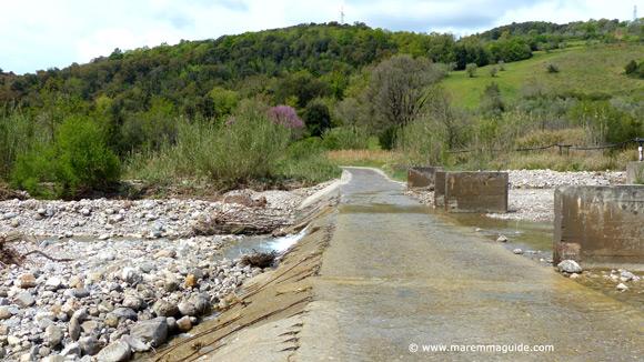 Track across the river Cornia near Lustignano Tuscany