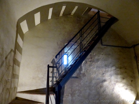 Stairs up the Rocca Aldobrandesca castle tower in Capalbio Italy.