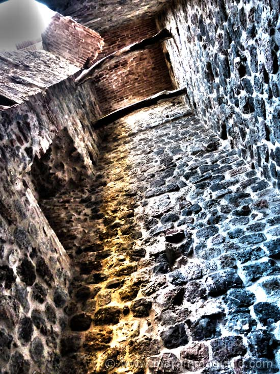 Inside the Rocca Aldobrandesca di Talamone looking up where the original staircase would have been.