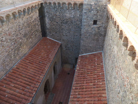 Internal courtyard of the Rocca Aldobrandesca fortress in Talamone.