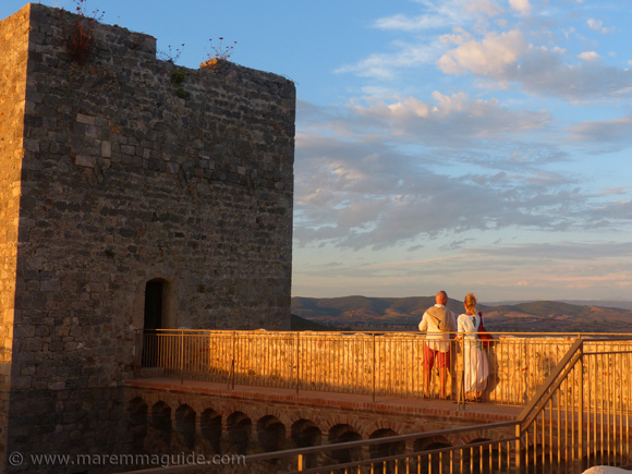 Rocca Aldobrandesca di Talamone Italy at sunset. Romantic places to visit in Tuscany.