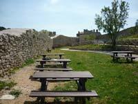Picnic seating at the middle ages castle of La Rocca di Campiglia Marittima in Maremma Italy