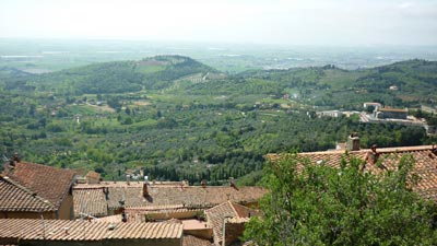 View from La Rocca di Campiglia Marittima of part of the medieval borgo below, the church of Pieve di San Giovanni, and the Maremma countryside