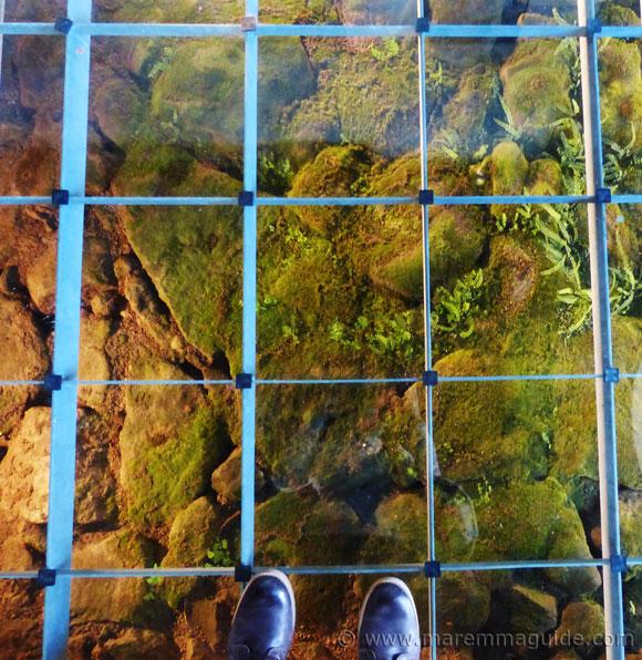 Glass floor with medieval road beneath in the Chiesa della Madonna delle Neve in Santa Fiora, Maremma Tuscany.