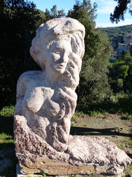 Sassetta Simposio di Scultura: red marble statue