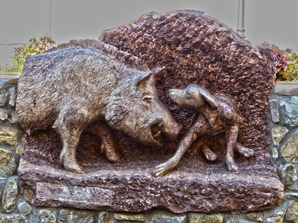 Wild boar and dog sculpture in Sassetta Tuscany Italy