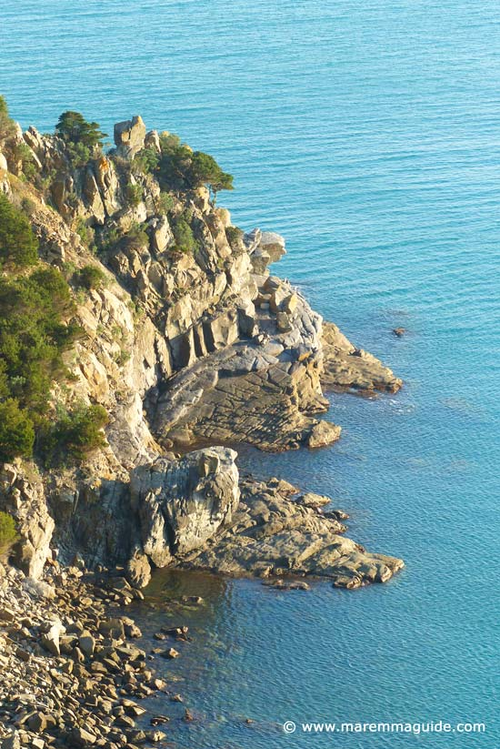 Secret rocky cove near Punta Ala Maremma Tuscany