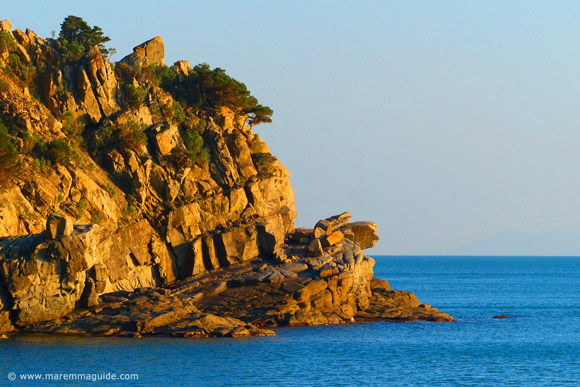 Sunst on the Maremma coast rocks