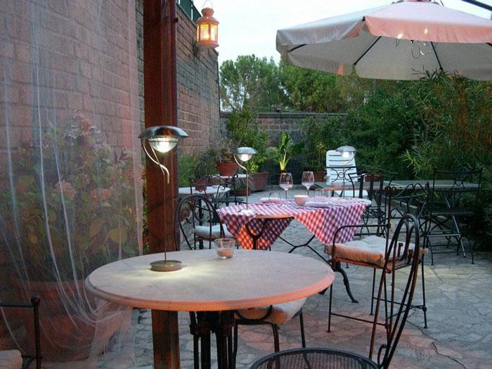 Terrace garden early evening at the Locanda la Pieve hotel in Semproniano Tuscany Italy