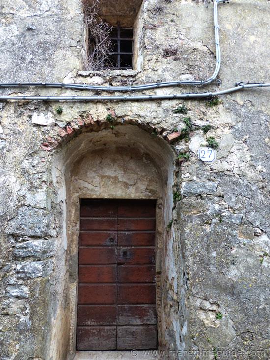 Semproniano Tuscany door cut into the original medieval city walls