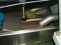 Olio extravergine di oliva and water leaving the cold press extraction machine