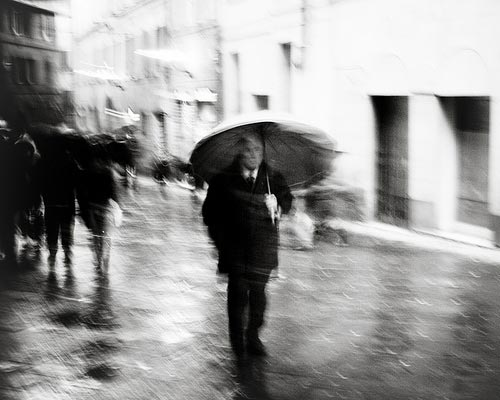 Siena photos: a black and white image of a Sienese street in the rain