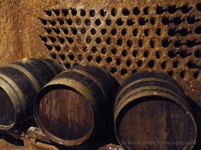 Sorano Italy wine cellar carved deep into the tufa rock.