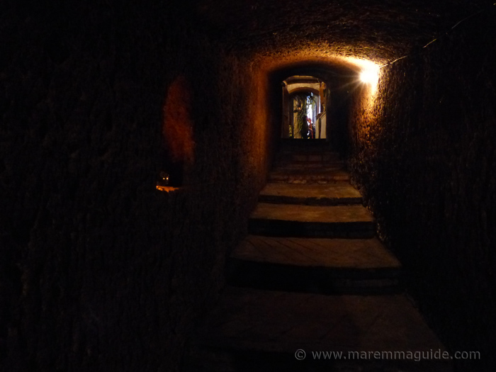 The underground world of Sorano's wine cellars.