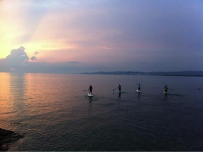 StandUp Paddle surf at Puntone beach Maremma Tuscany Italy