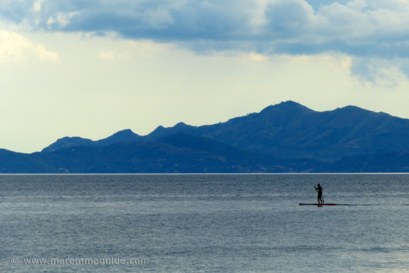 SUP in Maremma Tuscany: Il Pino beach Piombino with the Isola d'Elba in the distance.