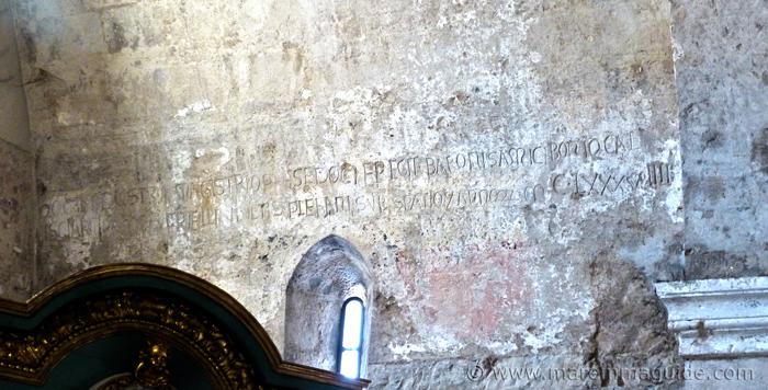 Suvereto Pieve di San Giusto: signatures of Romanesque master builders Barone di Amico and Bono di Calcisciano carved into the cgurch transept wall.