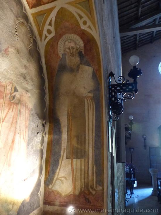 Suvereto: detail of the fresco Madonna col Bambino tra i santi Giovanni Battista e Jacopo e i donatori. San Benedetto.