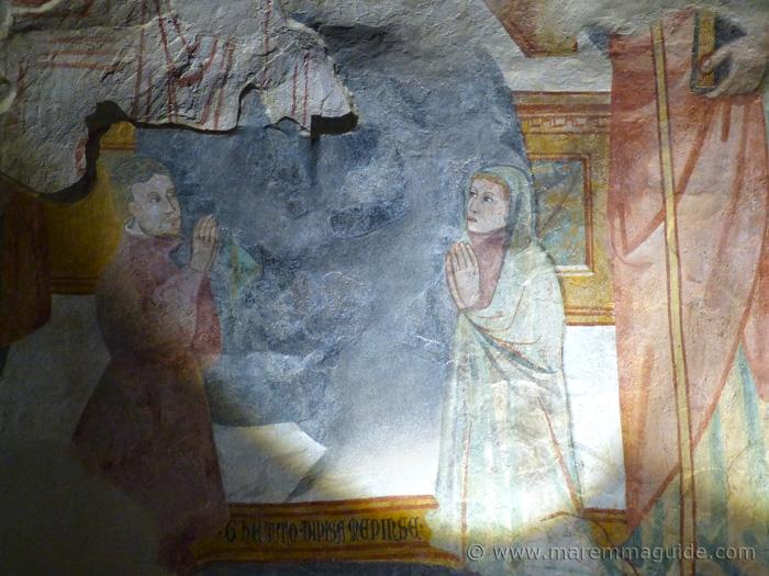 Suvereto. Detail of the Madonna col Bambino tra i santi Giovanni Battista e Jacopo e i donatori. Signature of artist Ghetto di Jacob.