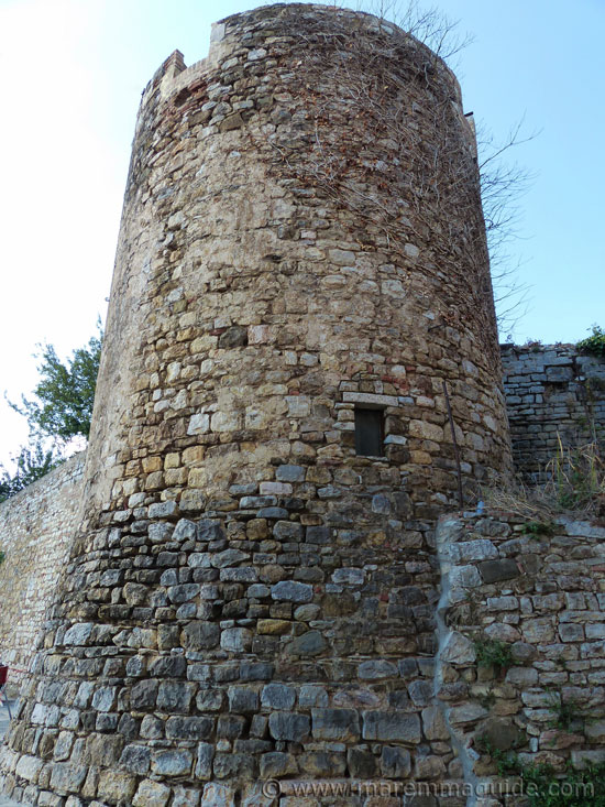 Suvereto: middle ages tower in city walls.