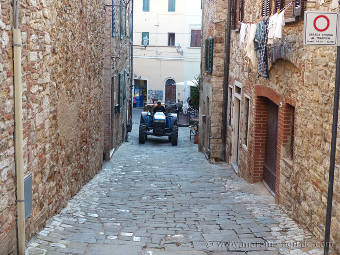 Tractor in a medieval street in Suvereto.