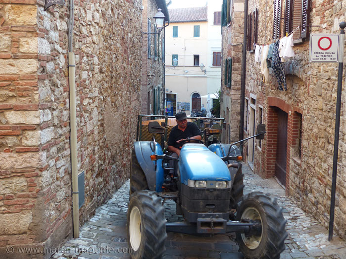 Tractor within the medieval city walls of Suvereto.