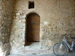 A medieval door in the castle entrance in Tatti, Maremma Italy