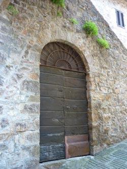 Medieval door in Tatti Maremma Italy