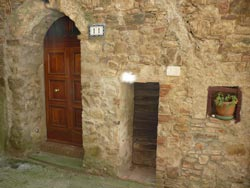 Two middle ages entrances in Tatti Maremma Italy
