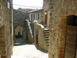 The medieval arched portal entrance to Tatti in Maremma