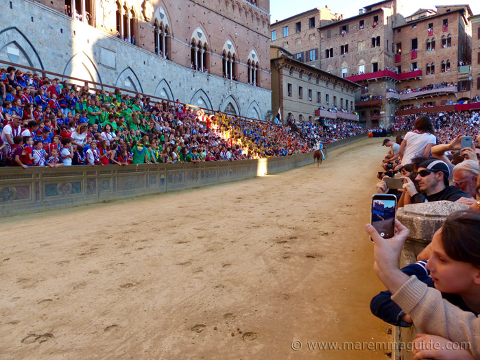 The Palio di Siena race track in front of Plazzo Pubblico heading up to the Curva del Casato.